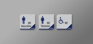 Placas das instalações sanitárias